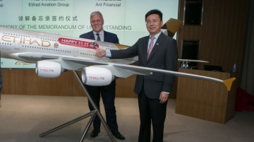 From left Lindsay White, vice president, Asia Pacific,  Etihad Airways, presenting an Etihad aircraft model with special 11.11 livery to Jerrry Hu, vice president, Alibaba Group.