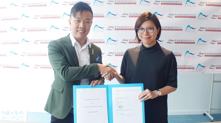 Yeung, right, and Ng, left, with the signed co-operation agreement