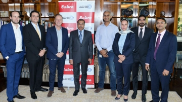 Dadabhai and Sabre executives at signing ceremony