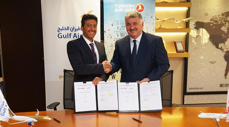 Waleed Abdul Hameed Al Alawi (left) signing agreement with Bilal Ekşi, CEO, Turkish Airlines (right)